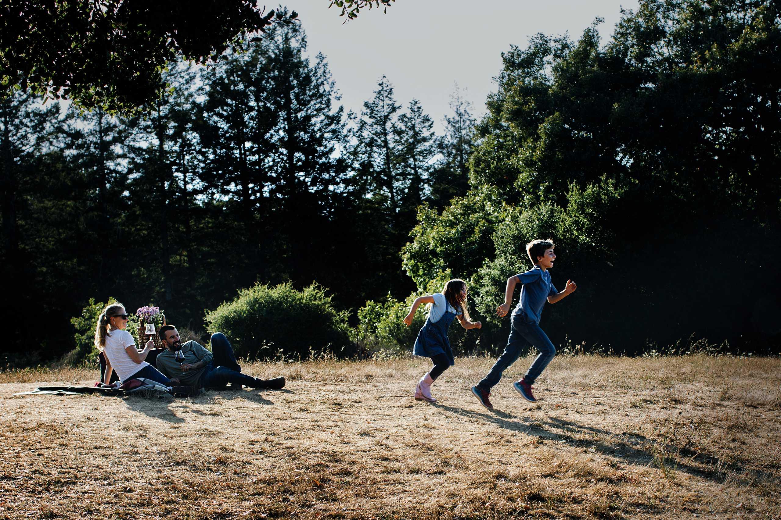kids running across grass