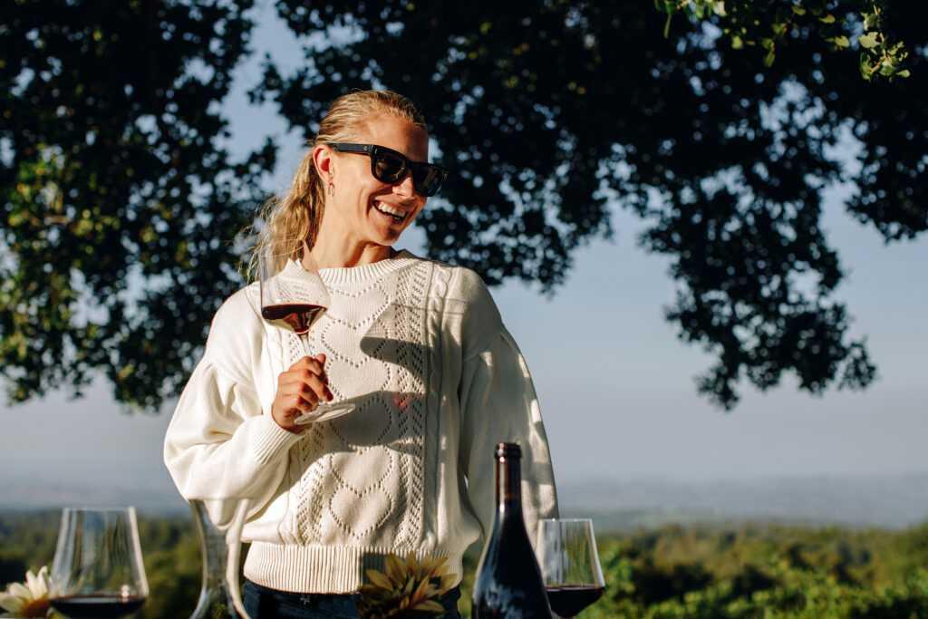Hilary holding wine glass