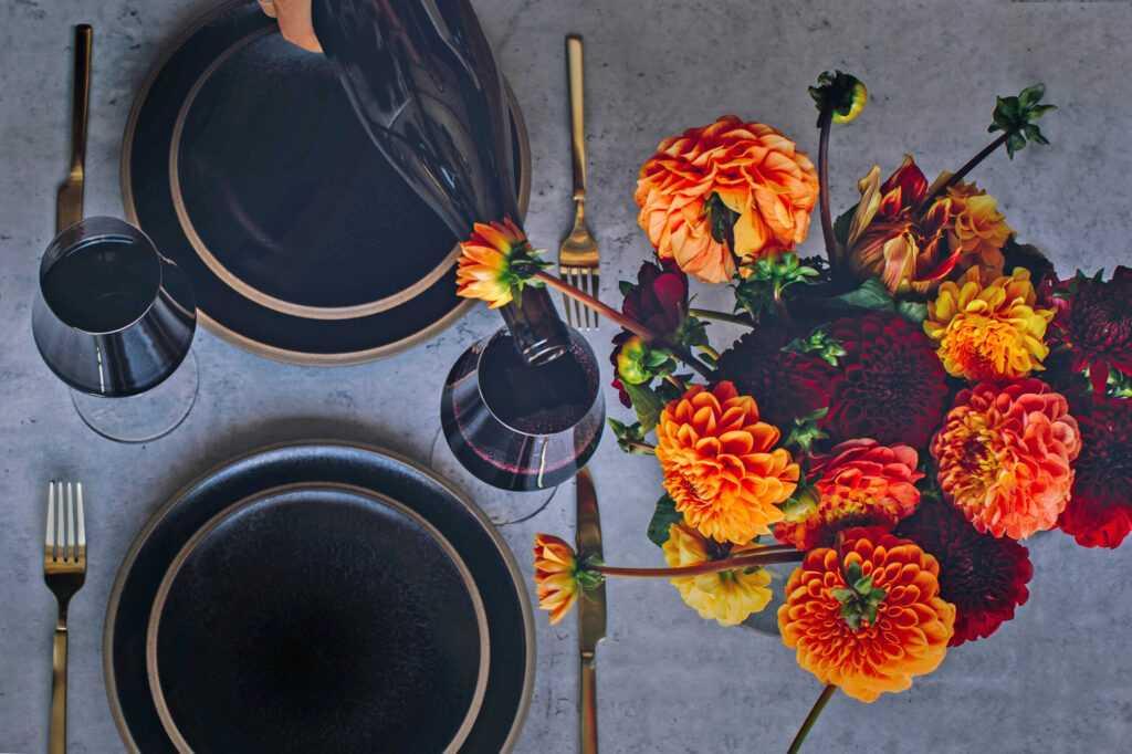dahlias and plates set for dinner